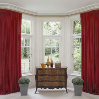 Bay window curtains on a channelled pole