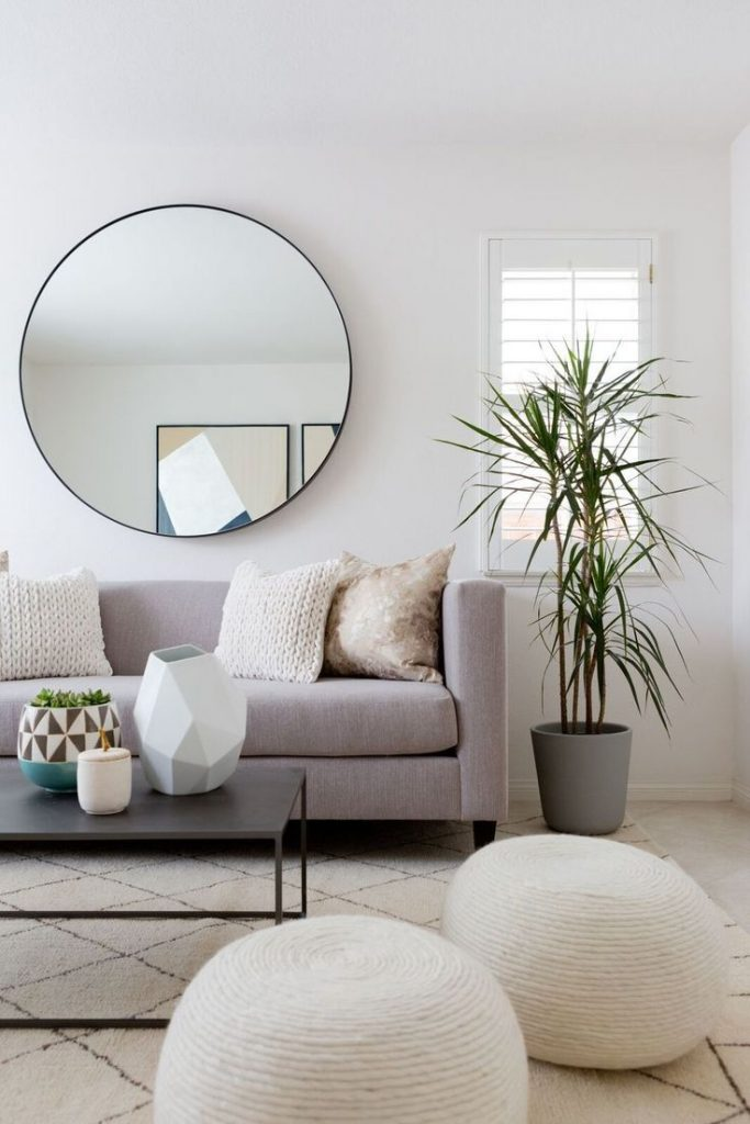 round decorative mirror makes a room brighter