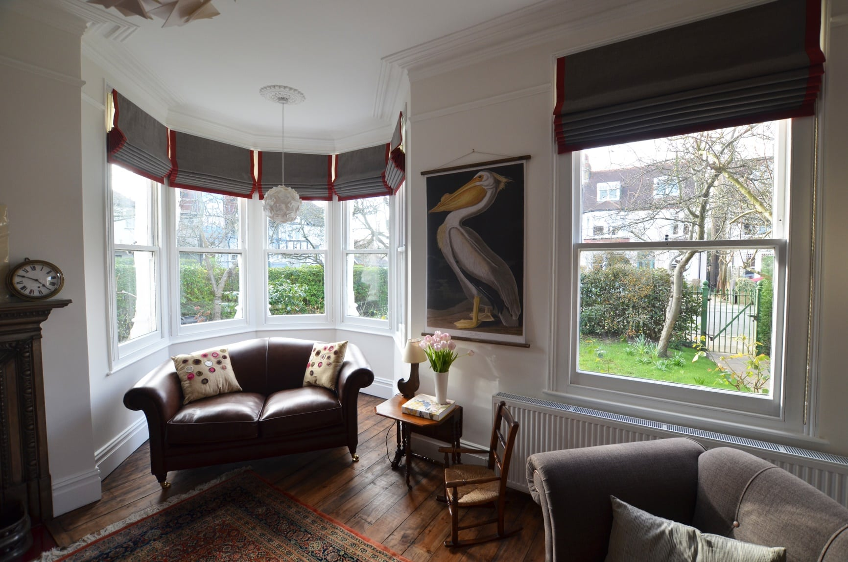 Designer roman blinds in a bay window